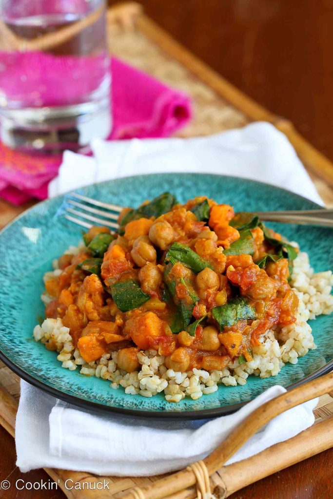 This vegan curry recipe is a breeze to make in the crockpot. Packed with cauliflower, sweet potato, chickpeas and plenty of flavor! 181 calories and 2 Weight Watchers Freestyle SP #slowcooker #vegetarian #curry