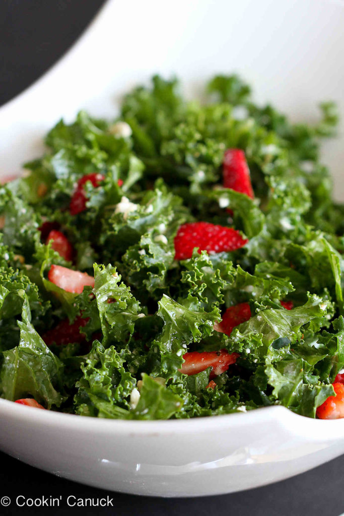 Feta cheese, strawberries and hazelnuts add a ton of flavor to this delicious kale salad recipe! 187 calories and 4 Weight Watchers Freestyle SP #vegetarian #salad