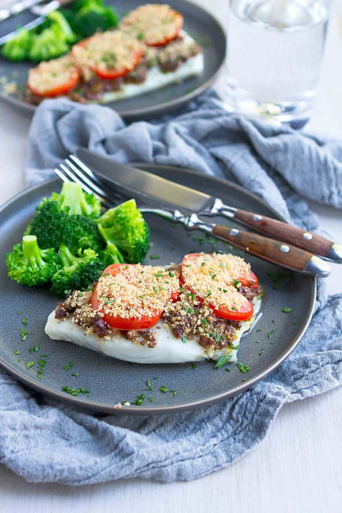 15 minute meal! Baked cod with olive tapenade is one of the easiest, healthiest meals in my recipe arsenal. Plus, it's inexpensive to make. It's a win-win-win! 164 calories and 2 Weight Watchers SmartPoints #cod #recipe #weightwatchers #dinner