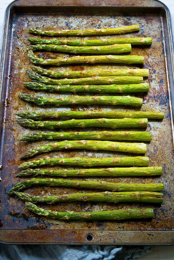 Need a springtime side dish? This easy asparagus recipe has fantastic flavor with just a few ingredients. #asparagusrecipes #roasted #vegetable