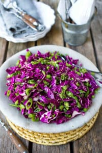 Have you ever made a slaw with snap peas? Bursting with flavor and color, this Hoisin Snap Pea & Red Cabbage Slaw is fantastic on its own or piled on sliders or tacos. 85 calories and 2 Weight Watchers Freestyle SP. #weightwatchers #slaw #healthy