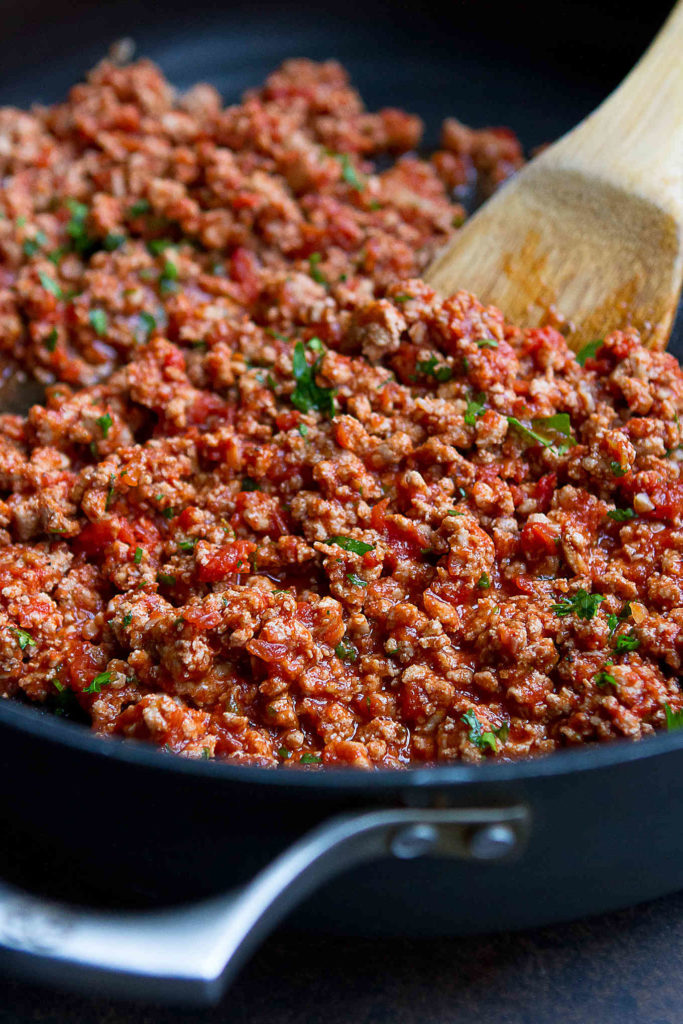 Ground turkey cooked with spices, garlic and crushed tomatoes in a large nonstick skillet.
