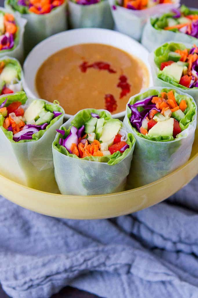 Vegan spring rolls with peanut sauce are my new obsession for light meals or appetizers! When you just don't feel like another salad, this is a fantastic way to fill up on veggies. 117 calories and 4 Weight Watchers Freestyle SP #vegan #recipe #weightwatchers