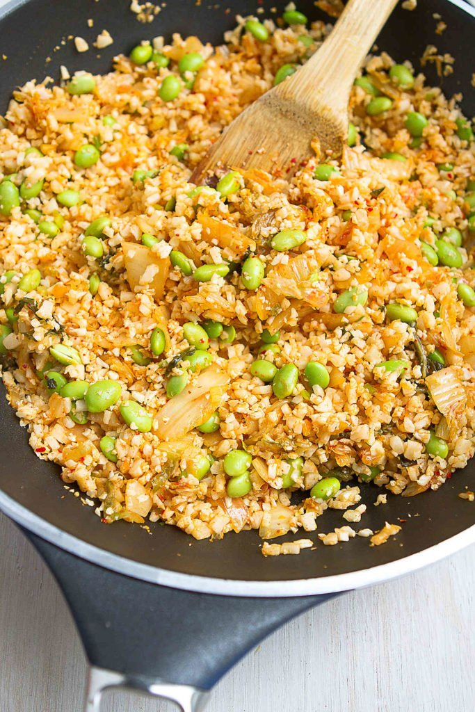 Cauliflower fried rice with kimchi and edamame in a large nonstick skillet.
