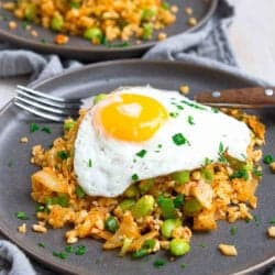 Boost your gut health in the most delicious way with this Kimchi Cauliflower Fried Rice recipe! This dish is a breeze to make and can be served with or without the egg. 214 calories and 2 Weight Watchers Freestyle SP #kimchi #vegetarian #cauliflowerrice #weightwatchers