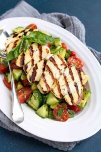 Chances are you won't be able to eat just one serving of this easy Cucumber Tomato Avocado Salad. The grilled halloumi cheese on top makes it utterly addictive. 102 calories and 3 Weight Watchers Freestyle SP #halloumi #avocado #salad #weightwatchers