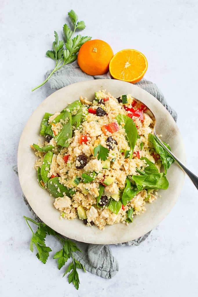 The ultimate potluck salad! This Moroccan Chicken Quinoa Salad can be made ahead of time and serves up a ton of flavor in every bite. 251 calories and 5 Weight Watchers Freestyle SP #quinoa #weightwatchers #glutenfree