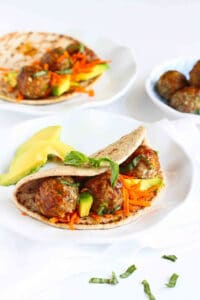 This takes meatball sandwiches to a whole new level! The flavors in this Asian Meatball Sandwich recipe are beyond delicious. Sweet and savory, with a side of healthy. 341 calories and 9 Weight Watchers Freestyle SP #sandwich #meatballs #avocado