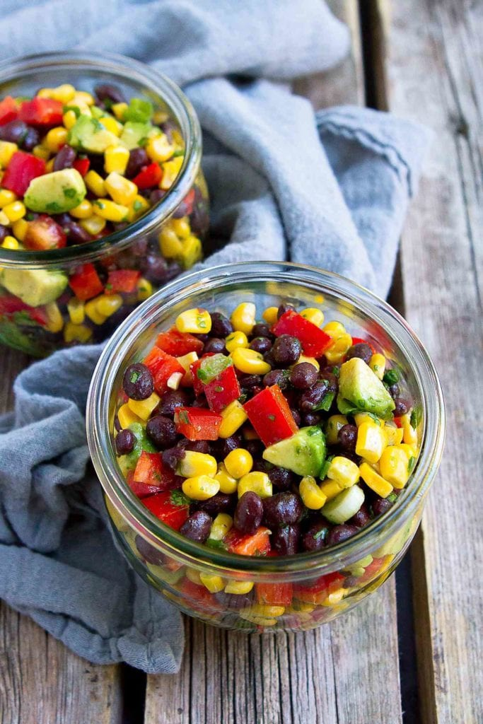 Once you taste this 10-minute fresh and flavorful Black Bean and Corn Salad, you'll want to serve it at every summertime barbecue. 129 calories and 2 Weight Watchers Freestyle SP #beansalad #vegan #weightwatchers