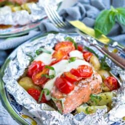 Fantastic for camping or mid-summer meals, these Caprese Potato Salmon Foil Packets are one of our favorite meals. So much flavor in every bite! 404 calories and 7 Weight Watchers Freestyle SP #salmon #weightwatchers #camping