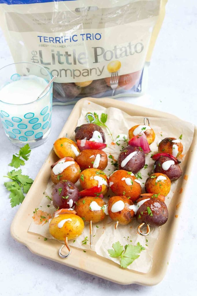 Grilled potato kabobs, brushed with Buffalo sauce & dipped into a blue cheese yogurt, make a fantastic summertime side dish! #CreamerPotatoes 72 calories and 3 Weight Watchers Freestyle SP #sidedish #wwfreestyle