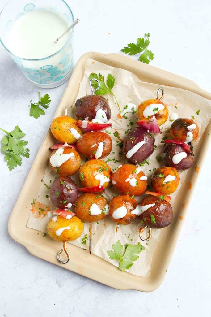 Spice up your summertime table with these Buffalo Grilled Potato Kabobs! Served with an easy blue cheese yogurt dip. 72 calories and 3 Weight Watchers Freestyle SP #grilled #potato #wwfreestyle
