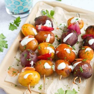 Kick up your side dish game with these Buffalo Grilled Potato Skewers. Drizzled with a yogurt blue cheese sauce, they're perfect for summertime entertaining. 72 calories and 3 Weight Watchers Freestyle SP #potatoes #grilling #weightwatchers