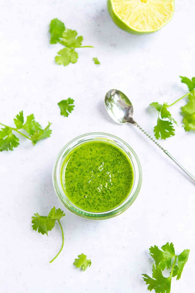 Keep this Cilantro Lime Dressing on hand to toss with your salad or drizzle is on top of shrimp or fish tacos. Easy, zippy & versatile! 49 calories and 2 Weight Watchers SP #dressing #wwfreestyle