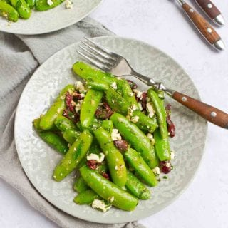 Fresh sautéed sugar snap peas combined with creamy feta cheese, briny olives and zesty garlic make this easy side dish an instant family favorite. 73 calories and 2 Weight Watchers Freestyle SP #snappeas #weightwatchers #sidedish