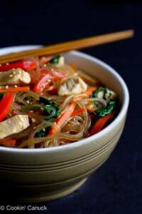 If you've never tried Korean glass noodles, now's the time! This sweet potato noodle recipe, called Japchae, is filled with chicken, vegetables & tons of flavor! 284 calories and 7 Weight Watchers Freestyle SP #glassnoodles #japchae #weightwatchers