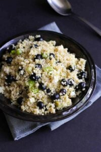 Punch up the flavors of your summertime meal with a dose of this Quinoa, Avocado and Blueberry Salad, finished off with feta cheese and a tangy lime vinaigrette. The perfect potluck salad! 121 calories and 4 Weight Watchers Freestyle SP #quinoa #saladrecipes #weightwatchers