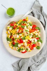 Serve up this Shrimp Corn Tomato Salad as a main dish or offer it as a side dish at your next backyard barbecue. Tons of flavor with so little effort! 183 calories and 2 Weight Watchers Freestyle SP #shrimp #saladrecipes #weightwatchers