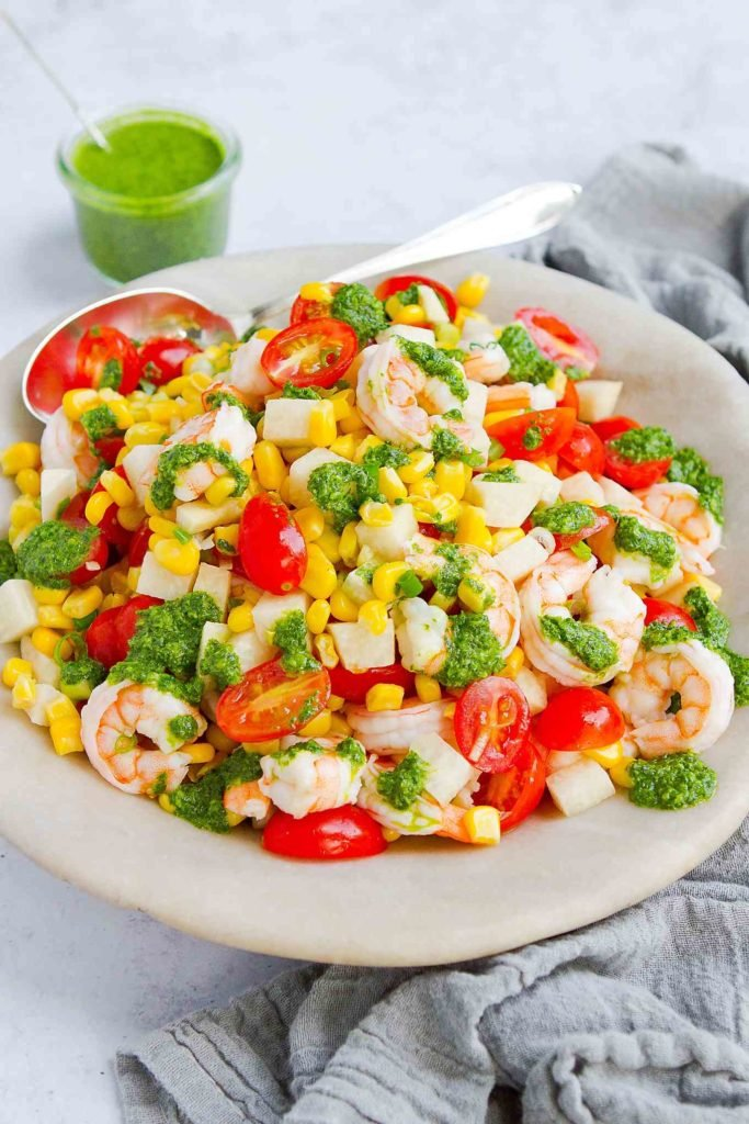 This corn and tomato salad with shrimp and jicama comes together in less than 20 minutes. Serve it as a side dish or entree. 183 calories and 2 Weight Watchers Freestyle SP #shrimprecipes #wwfreestyle #cleaneating