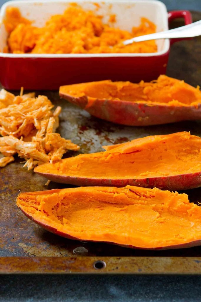 Cooked sweet potatoes with the flesh scooped out.
