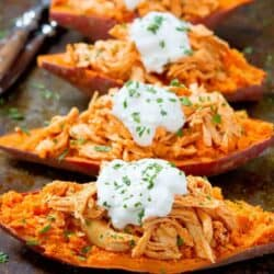 20 minute meal! These Buffalo Chicken Sweet Potato recipe is topped off with a light blue cheese yogurt sauce. An easy weeknight dinner recipe! 240 calories and 4 Weight Watchers SP #sweetpotato #healthydinner #weightwatchers