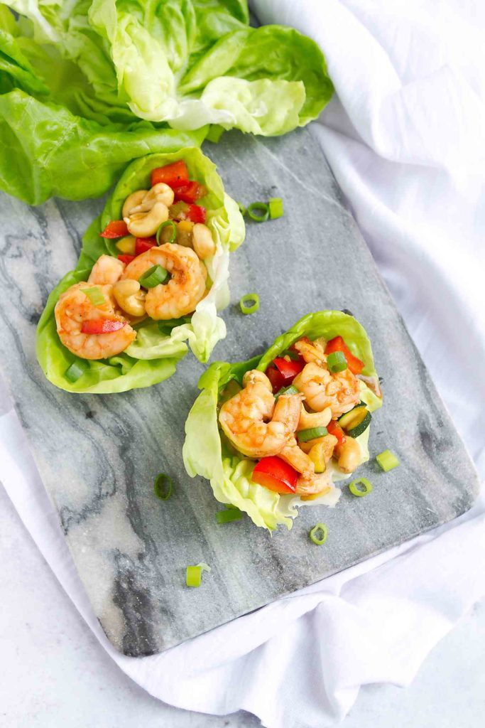 Lettuce wraps are a fantastic way to lighten up any meal, and this cashew shrimp version is sure to become a family favorite! 169 calories and 3 Weight Watchers SP #shrimprecipes #wwfreestyle #healthyeating