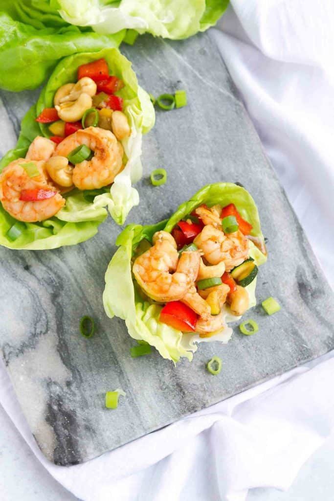Cashew shrimp is always a favorite takeout meal, but it's super simple - and healthier! - to make at home. Cook up a batch and serve as lettuce wraps for a light meal or appetizers. 169 calories and 3 Weight Watchers SP #shrimp #weightwatchers #lettucewraps