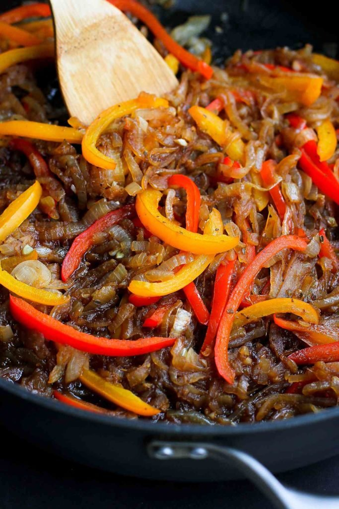 Bell pepper slices and caramelized onions in a large nonstick skillet.
