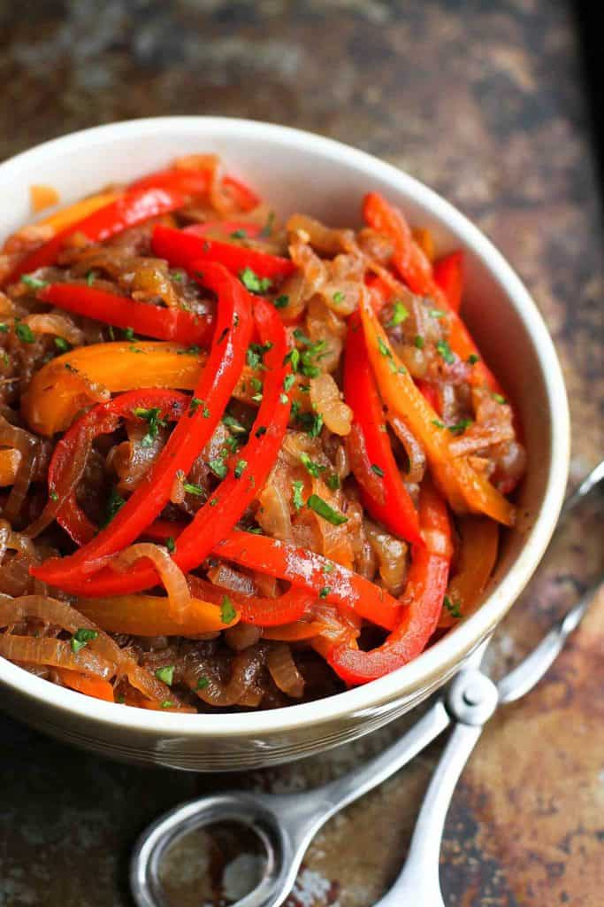 This balsamic peppers and onions recipe is so easy and versatile that we often make a double batch and store the leftovers in the freezer for another meal. Serve them on sausage, chicken or even pizza. 94 calories and 1 Weight Watchers Freestyle SP #vegan #peppersandonions #healthyrecipes