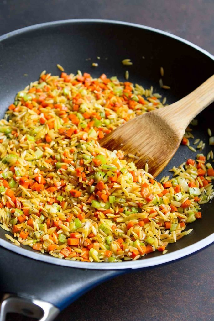 Toasted orzo, carrot and celery in a large nonstick skillet.
