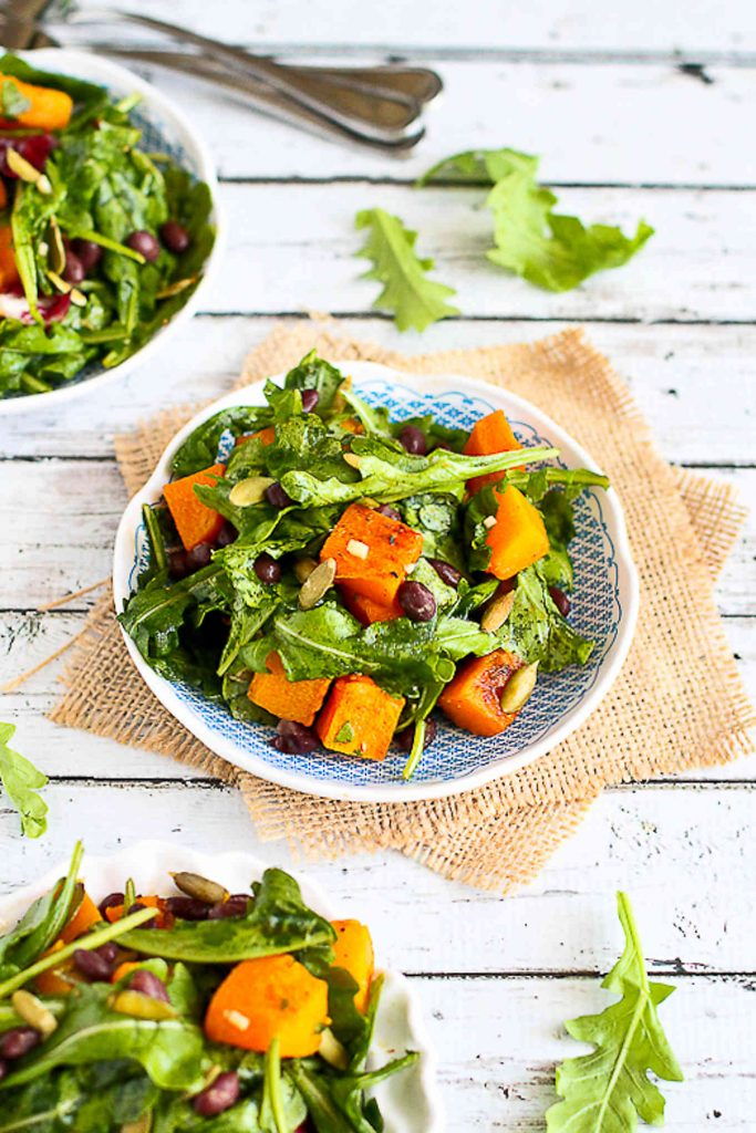Butternut squash, black beans, arugula and a zippy dressing are fantastic together as a vegan dinner recipe on a busy weeknight. 219 calories and 2 Weight Watchers SP | Warm | Arugula | Vegan | Vegetarian | Black Beans | Healthy #veganrecipes #vegandinner #weightwatchersrecipes