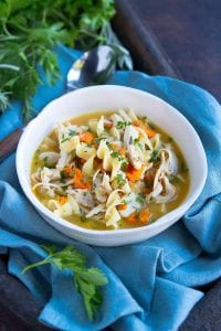 Put that leftover turkey to good use in this comforting, healthy Turkey Noodle Soup (Instant Pot or stovetop). Filled with fresh herbs. 255 calories and 5 Weight Watchers SP | Pressure Cooker | Homemade | Recipe | Easy | Healthy | Left Over | Instapot | From Scratch #turkeysoup #instantpot #pressurecooker #weightwatchers #leftoversrecipes #souprecipes