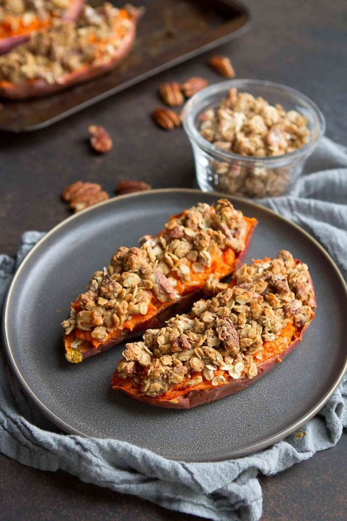 Swap out the sweet potato casserole with these sweet potatoes with pecan streusel topping. 240 calories and 10 Weight Watchers SP | Healthy | Easy | Savory | Thanksgiving | Side Dish | Holiday Recipes | Vegan | Vegetarian | Make Ahead #healthysides #makeaheadrecipes #bakedpotatoes #weightwatchersrecipes #holidays