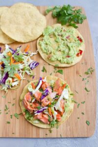 Another 20 minute meal! My family LOVED these Salmon Tostadas with Guacamole, and they couldn't be easier to make. 255 calories and 5 Weight Watchers SP   Mexicanas   Healthy   Shells   Easy   Fish   How To Make #salmontostadas #fishtostadas #smartpoints #weightwatchers #salmonrecipes