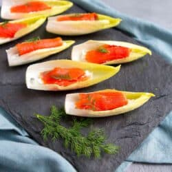 Looking for an easy holiday appetizer? A batch of Smoked Salmon Endive Boats can be made in about 15 minutes. Then watch them disappear from the plate in seconds! 76 calories and 1 Weight Watchers SP | Appetizers | Vegetarian | Healthy | Parties | Finger Food | New Year's Eve | Stuffed | Hors D'Oeuvres | Simple #appetizerrecipes #smokedsalmon #newyearseve #fingerfood #horsdoeuvres #smartpoints #weightwatchers