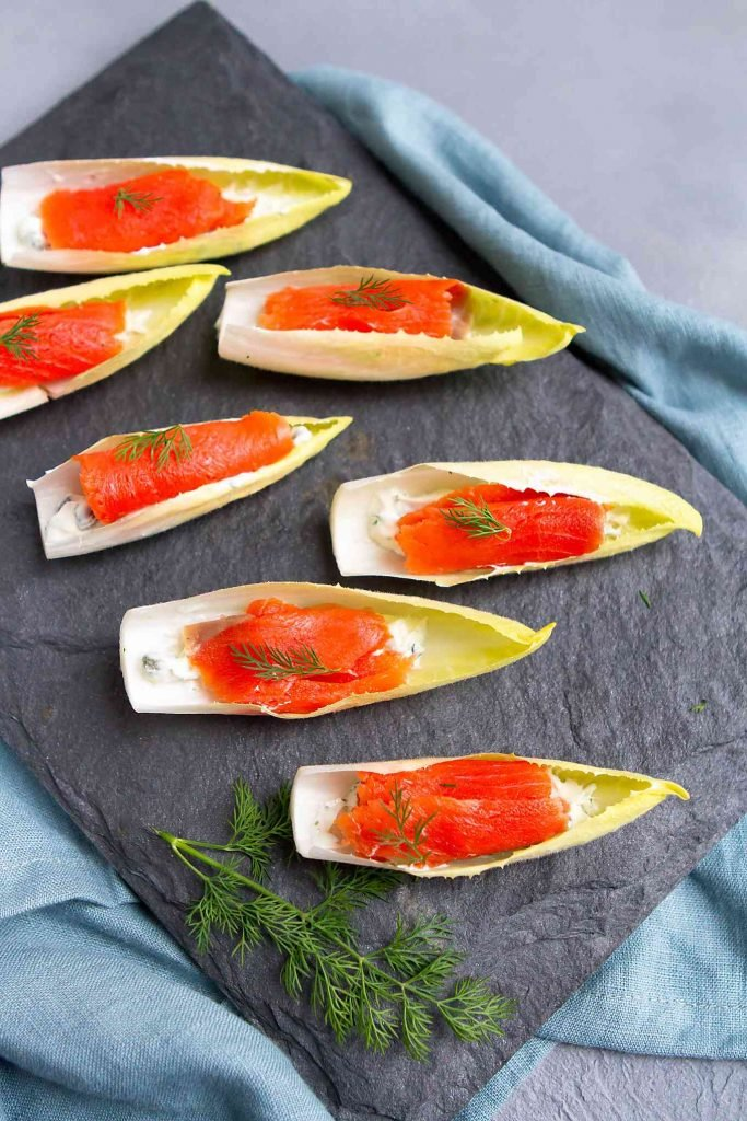 New Year's Eve hors d'oeuvres or healthy game day snacking. This smoked salmon endive boat recipe are quick and easy! 76 calories and 1 Weight Watchers SP | Appetizers | Vegetarian | Healthy | Parties | Finger Food | New Year's Eve | Stuffed | Hors D'Oeuvres | Simple #appetizerrecipes #smokedsalmon #newyearseve #fingerfood #horsdoeuvres #smartpoints #weightwatchers