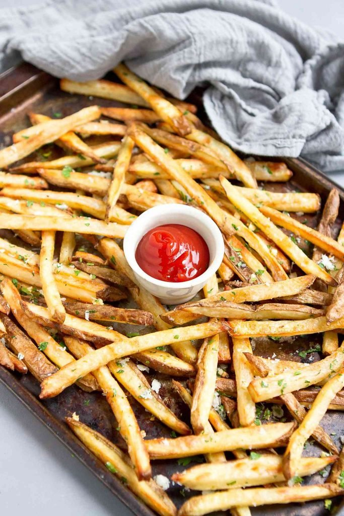 Serve up these baked Garlic Parmesan Fries for game day. They will disappear in a flash! 151 calories and 5 Weight Watchers SP | Oven | Homemade | Healthy | Easy | Seasoned | Best | Home Made | Super Bowl Recipes | With Cheese #bakedfrenchfries #ovenbakedfries #healthyfries #vegetarian #superbowlrecipes #wwrecipes #weightwatchers