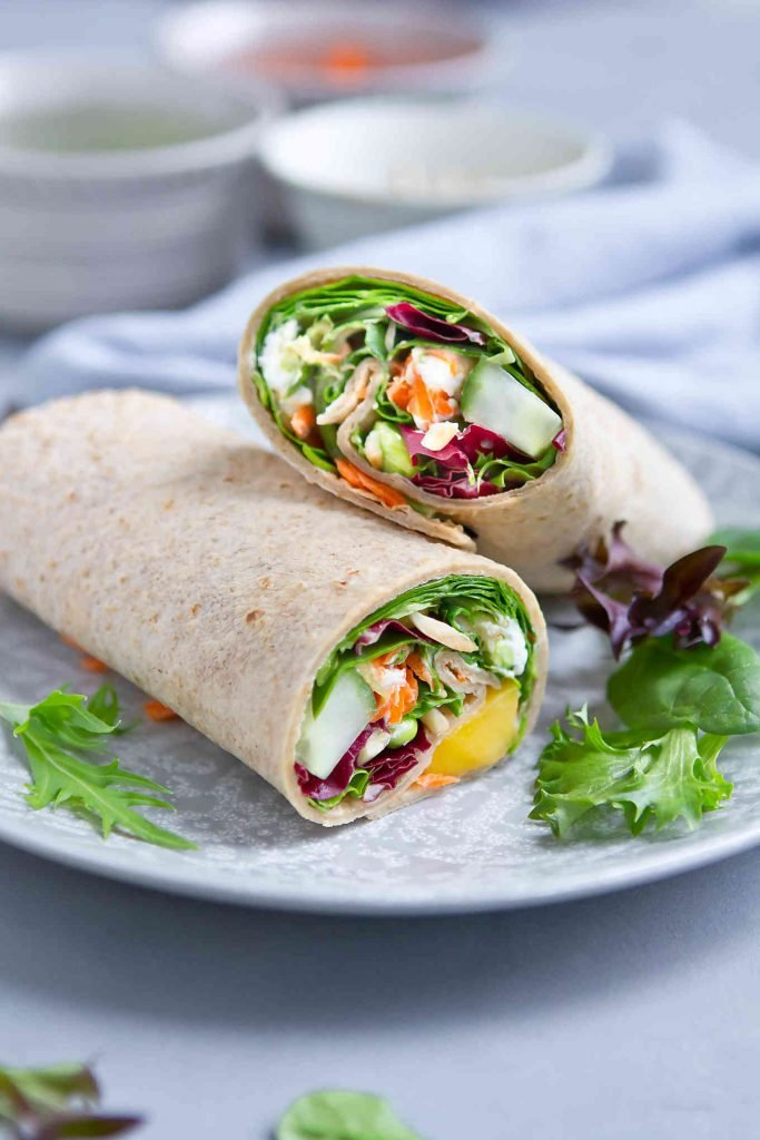 Take this tortilla wrap to work for a healthy lunch or serve it up as an easy meatless dinner on a busy night. 249 calories and 6 Weight Watchers SP | Lunches | Healthy | Easy | Tortilla | Cold | Meal Prep | Raw | Mediterranean | Vegetarian | Hummus #lunchideas #healthylunches #veggiewrap #tortillawrap #wrapsandwich #smartpoints #weightwatchers