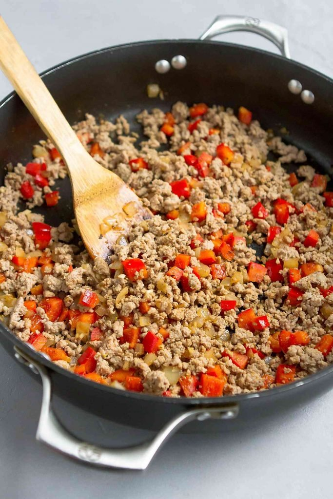 Ground turkey, bell pepper and onion in a large nonstick skillet
