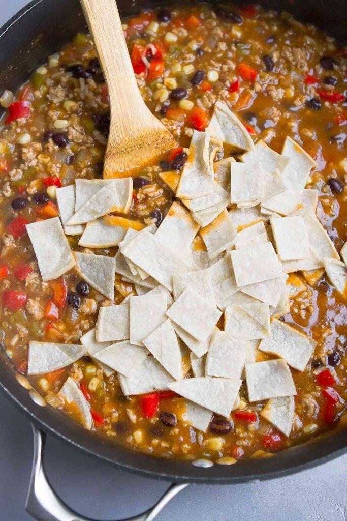Corn tortilla strips on a southwestern ground turkey mixture.