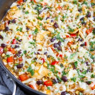 This one-pot Ground Turkey Enchilada Skillet Meal got rave reviews all around from my family. This will be a regular at our dinner table, for sure! 375 calories and 6 Weight Watchers SP | Healthy | Recipe | Easy | One Pot | One Pan | Green #groundturkey #enchiladas #onepotmeal #onepanmeal #healthydinners #wwrecipes #smartpoints