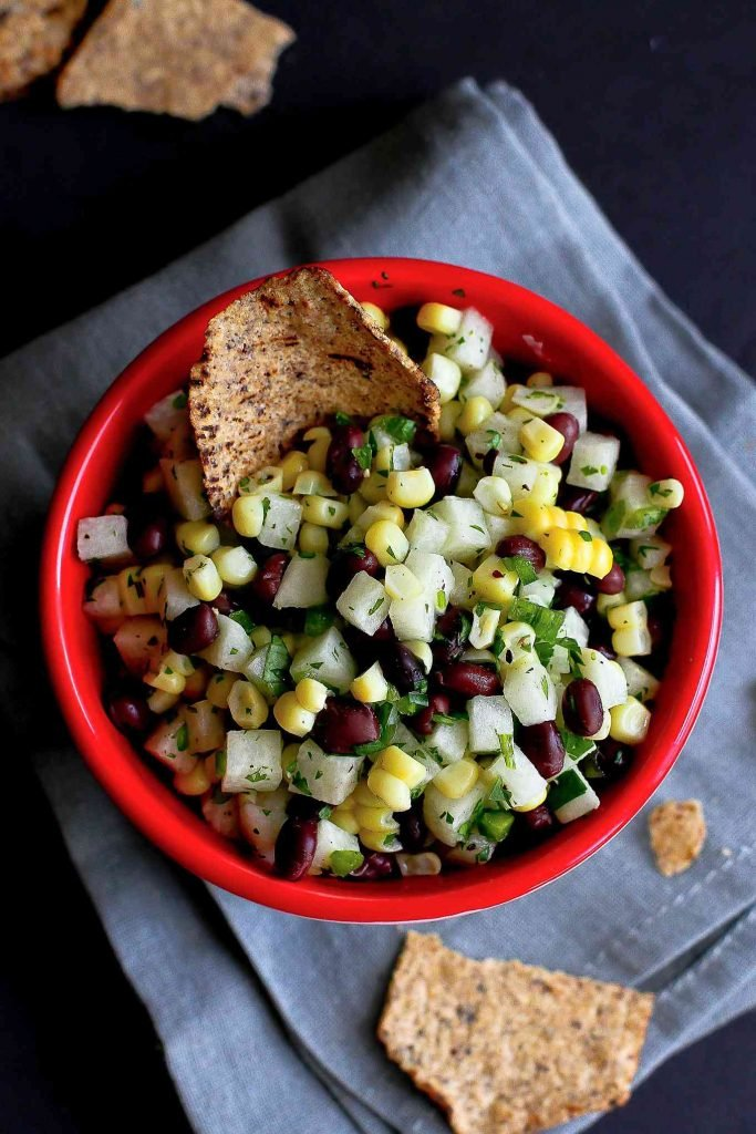 Snack on this black bean corn salsa or serve it on tacos. It has a fantastic crunch from some chopped jicama.. 36 calories and 0 Weight Watchers SP | Recipe | Easy | Dip | Mexican | Fresh | Vegan | Gluten Free | Tailgating | Plant Based | Super Bowl #veganappetizers #superbowl #veganrecipes #cornsalsa #tailgating #cleaneating #weightwatchers #plantbased