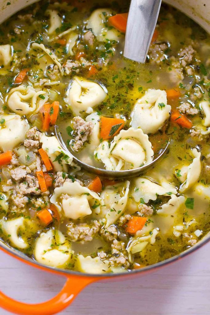 You can never have enough 30 minute recipes! This healthy Pesto Turkey Tortellini Soup recipe makes weeknight cooking easy. 230 calories and 4 Weight Watchers SP   Ground Turkey   Stovetop   Easy   Healthy   30 Minute Meal   Recipes   Broth #tortellinisoup #30minutemeals #easydinnerrecipes #souprecipes #healthysoups #weightwatchers #smartpoints