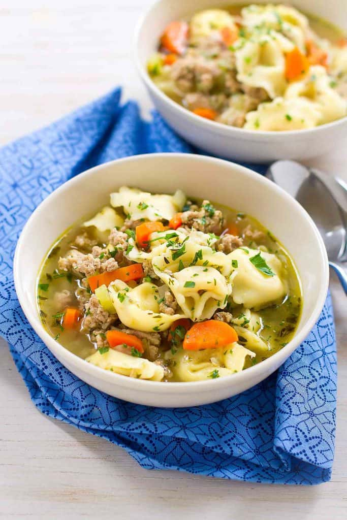 My family LOVES this Pesto Turkey Tortellini Soup recipe! And really, you can never have enough 30 minute recipes in your arsenal. 230 calories and 4 Weight Watchers SP | Ground Turkey | Stovetop | Easy | Healthy | 30 Minute Meal | Recipes | Broth #tortellinisoup #30minutemeals #easydinnerrecipes #souprecipes #healthysoups #weightwatchers #smartpoints