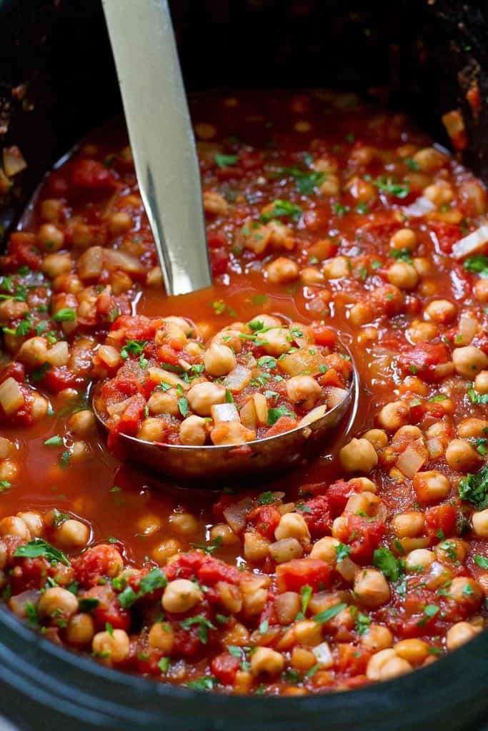 Pull out the crockpot for a batch of these vegan Slow Cooker Italian Chickpeas. Mix in some extra vegetables if you'd like and serve over rice or quinoa. 188 calories and 0 Weight Watchers SP | Crock Pot | Vegan | Vegetarian | Plant Based | Garbanzo Beans | Chana #plantbased #veganrecipes #slowcooker #crockpotrecipes #meatless #wwrecipes #smartpoints