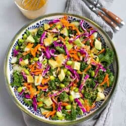 There's so much goodness in this superfood salad. Kale, avocado, cabbage, rice and more, all tossed with a miso dressing. Delicious! 143 calories and 4 Weight Watchers SP | Vegan | Plant Based | Anti Inflammatory | Mediterranean Diet | Recipe | Lunch Ideas | Meal Prep #plantbased #vegansalads #lunchideas #antiinflammatory #wwrecipes #smartpoints