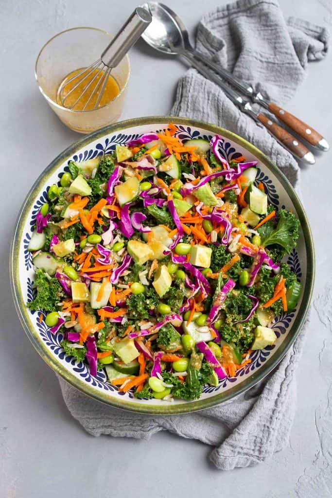 There is so much goodness in this superfood salad. Kale, avocado, cabbage, rice and more, all tossed with a miso dressing. Delicious! 143 calories and 4 Weight Watchers SP | Vegan | Plant Based | Anti Inflammatory | Mediterranean Diet | Recipe | Lunch Ideas | Low Carb | Meal Prep #plantbased #vegansalads #lunchideas #antiinflammatory #wwrecipes #smartpoints