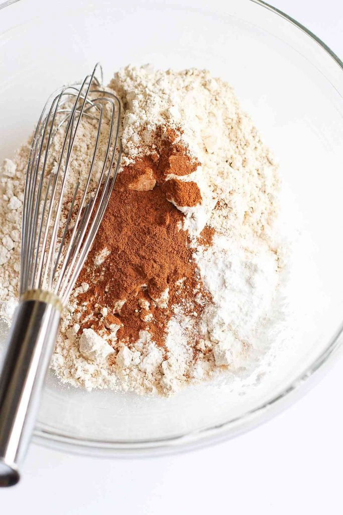 Whole wheat pastry flour, ground cinnamon and baking soda in a glass bowl