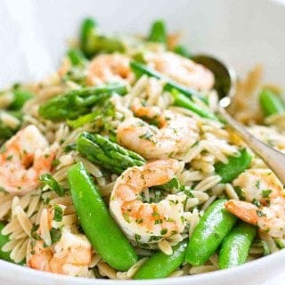 Welcome spring with this Shrimp Pasta Primavera Salad! Packed with asparagus and snap peas, it's perfect for a light dinner or picnic lunch. 219 calories and 4 Weight Watchers SP | With Lemon Dressing | Easy | Healthy | Recipes | Summer | Cold | Best | Orzo #pastasalad #picnicrecipes #potluckrecipes #shrimprecipes #weightwatchers #smartpoints