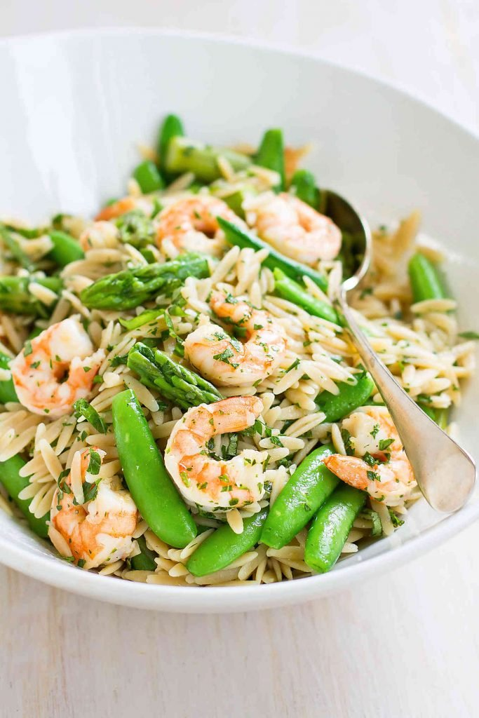 Whip up this Shrimp Primavera Pasta Salad for your next picnice or bbq. A great potluck dish or easy dinner recipe. 219 calories and 4 Weight Watchers SP | With Lemon Dressing | Easy | Healthy | Recipes | Summer | Cold | Best | Orzo | Asparagus | Snap Peas #pastasalad #picnicrecipes #potluckrecipes #shrimprecipes #weightwatchers #smartpoints
